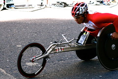 endurance sports(0.0), bicycle racing(0.0), road bicycle(0.0), bicycle motocross(0.0), bmx bike(0.0), cycle sport(0.0), road cycling(0.0), extreme sport(0.0), bmx racing(0.0), bicycle(0.0), racing(1.0), wheel(1.0), vehicle(1.0), sports(1.0), race(1.0), wheelchair racing(1.0), cycling(1.0),