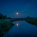 Blue moons reflection by Robert Stienstra Photography