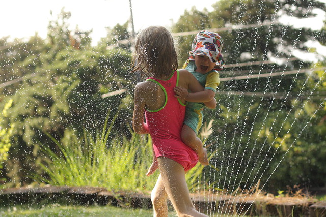 End of the day sprinkler fun (K to the rescue)