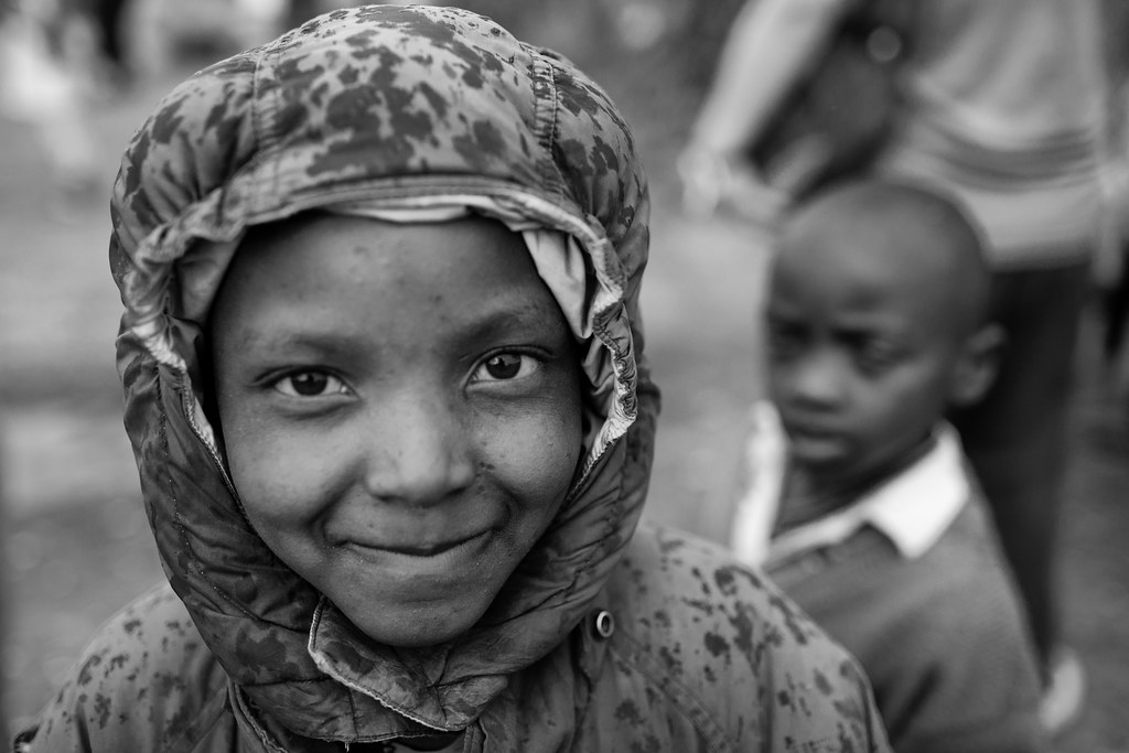 black and white p[ortrait of a child at an idp camp in kenya africa