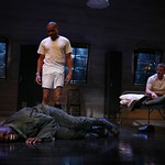 After a night of partying off-base, Roger (J.D. Williams, standing), and Billy (Brad Fleischer, sitting) wonder what to do about Carlysle (Ato Essendoh, lying down), who has decided to sleep on their bunker floor  in the Huntington Theatre Company's production of Streamers, directed by Scott Ellis, playing at the BU  Theatre, part of the 2007-2008 season. Photo: T. Charles Erickson.