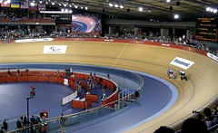 bullring(0.0), racing(1.0), bicycle racing(1.0), sport venue(1.0), vehicle(1.0), track cycling(1.0), sports(1.0), sports equipment(1.0), cycle sport(1.0), race track(1.0), stadium(1.0), bicycle(1.0), arena(1.0),