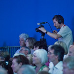Camera filming an event | A camera man films a Book Festival event
