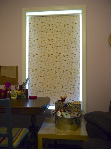 Fabric covered roller shade.