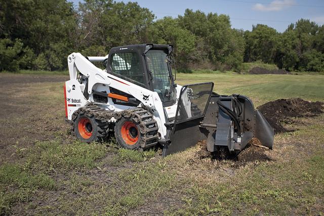 Series s750 skid steer loader with stump grinder flickr photo