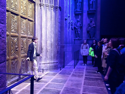 Our tour guide standing in front of the doors of the Great Hall, giving us a short summary before he lets us in