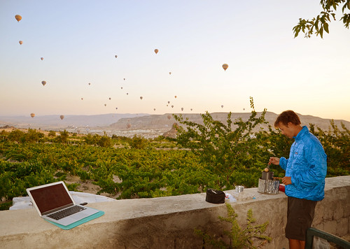 Eric boiling us some eggs for breakfast as the balloons pass by over Cappadocia