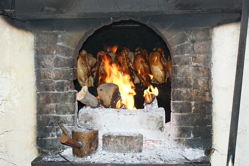 Beijing Roast Duck cooking in fire