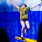 12-037 -- Kimberly Florian '16 tries the mechanical surf board at the Titan Carnival.