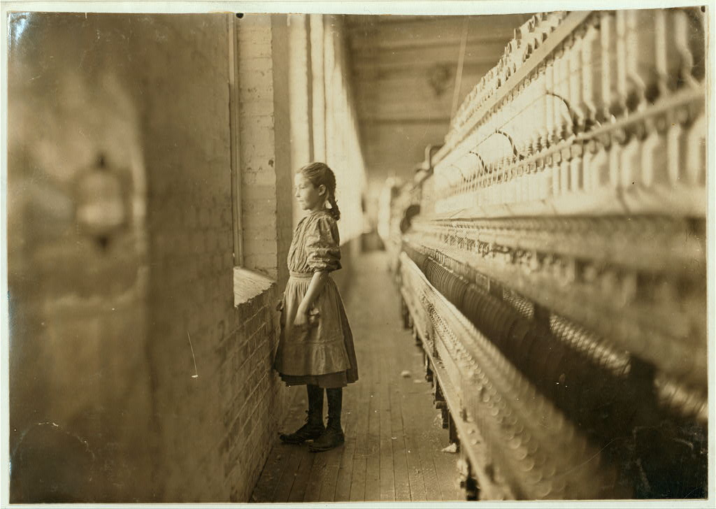 Rhodes Mfg. Co., Lincolnton, N.C. Spinner. A moments glimpse of the outer world. Said she was 10 years old. Been working over a year. Location: Lincolnton, North Carolina.