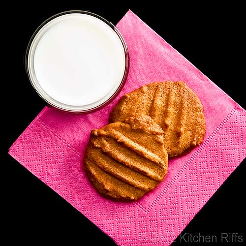 Peanut Butter Cookies on Napkin with Glass of Milk, Overhead View