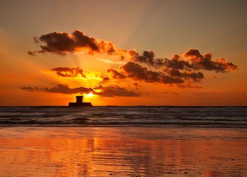 ocean sunset sea tower beach silhouette clouds reflections landscape sand waves shore jersey channelislands martello martellotower stouensbay stouens larocco stouensbeach