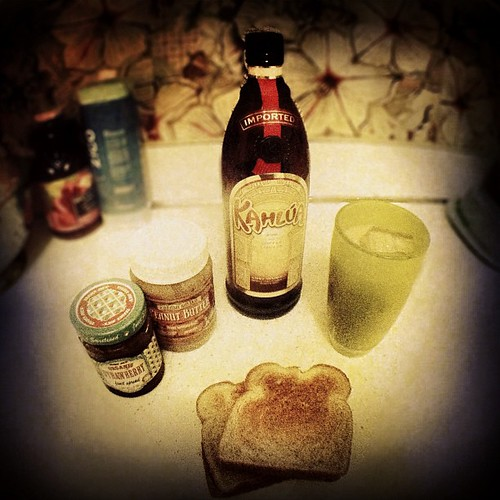 last night's parent survival kit: white russian in a tall cup and two pb&j's.