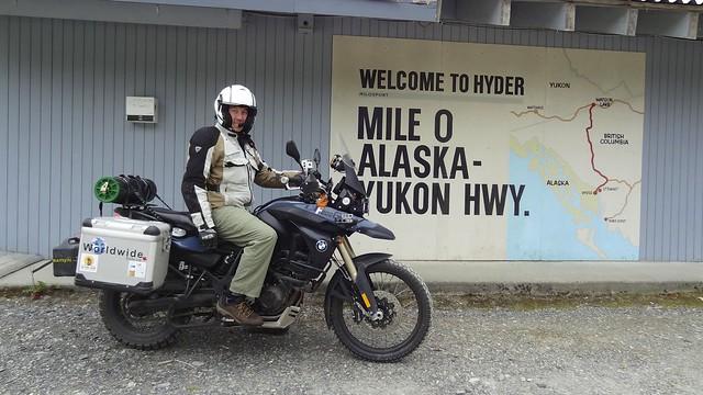 Daniel bike mile 0 Alaska hwy