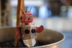 Pink metal clockwork robot maid - Naked Espresso Bar