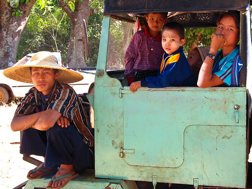Family  on a old fashion truck