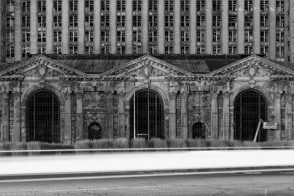 black and white image of an abandoned michigan central station in detroit at night