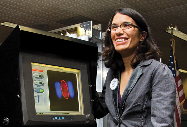 MagViz project leader Michelle Espy demonstrates the MagViz liquid detection and analysis system in the Albuquerque International Sunport.