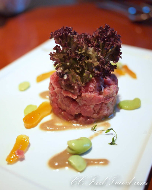 Beef tenderloin tartare with fresh fava beans, marinated apricot and light truffle 'Bagna Cauda'