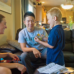 12-008 -- International students went to dinner with volunteer host families in their homes Sunday night. Hanlun Lu and An Nguyen were hosted by John '91 and Ann Hansen and 4-year-old son Caden.
