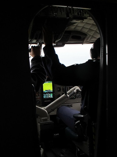 Inside the Twin Otter, pilots at work