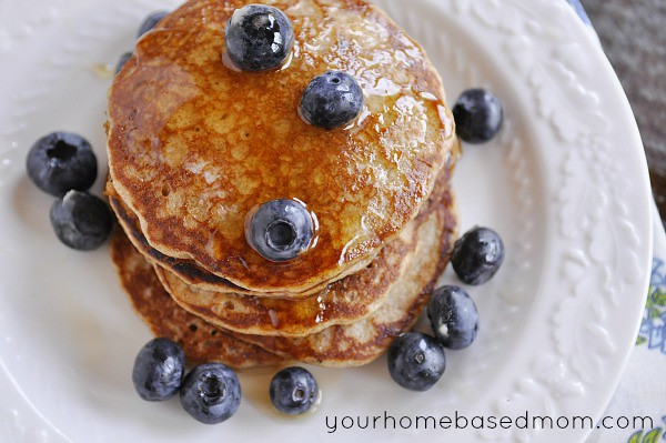 Whole Grain Pancakes syrup blueberries on a white plate