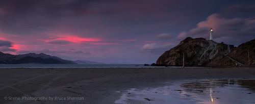 sunset newzealand lighthouse reflections castlepoint wairarapa