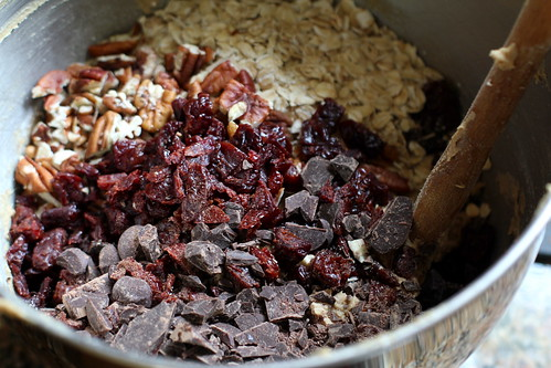 add the mix-ins: oats, toasted pecans, dried cherries, chocolate
