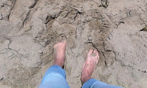 feet in the sand in Malibu