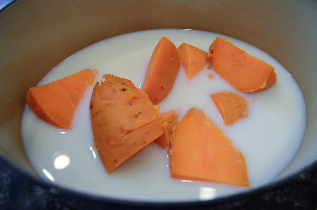 Large pieces of sweet potato are added into the pot.