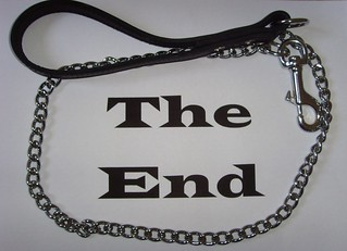 a sign that says THE END surrounded by a chain