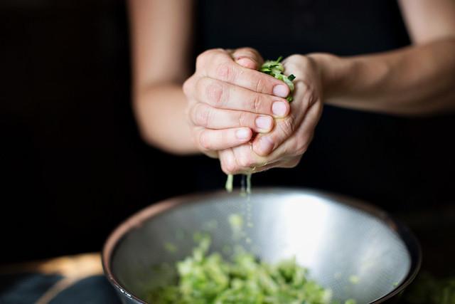 squeezing zucchini