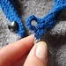 Crocheted button loop for knit cardigan
