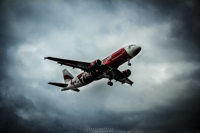 Air Asia Overcast Landing by flickr user kamgtr