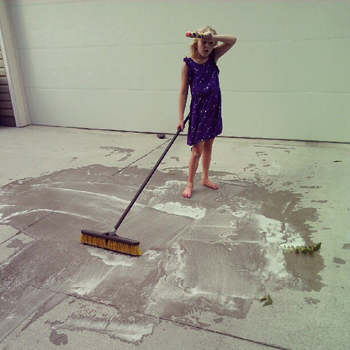 Workin' hard. (Totally staged. She loves cleaning the driveway for Grampaw.)