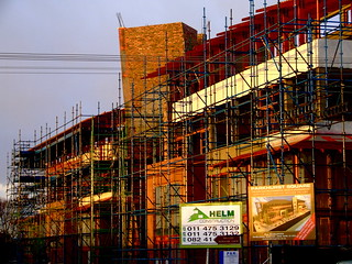 Parkhurst, Johannesburg, construction in late afternoon light after thunderstorm.