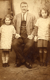 Two girls with their father