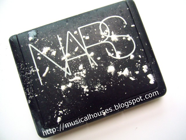 cleaning sticky nars compact front