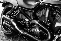 automobile(1.0), wheel(1.0), vehicle(1.0), automotive design(1.0), exhaust system(1.0), motorcycle(1.0), monochrome photography(1.0), engine(1.0), motorcycling(1.0), land vehicle(1.0), monochrome(1.0), black-and-white(1.0), black(1.0),