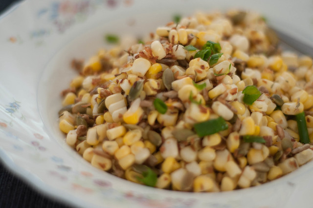 corn salad with seeds, coconut and herbs