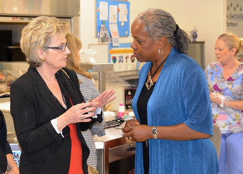 FNS Administrator Audrey Rowe chats with West Virginia Superintendent of Schools Dr. Jorea Marple  at a Back To School Breakfast Event at Piedmont Year-round Elementary School in Charleston, West Virginia August 7.