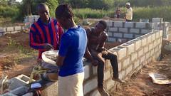 Girl selling boiled corn at construction site, Ushafa Village, FCT, Nigeria. #JujuFilms