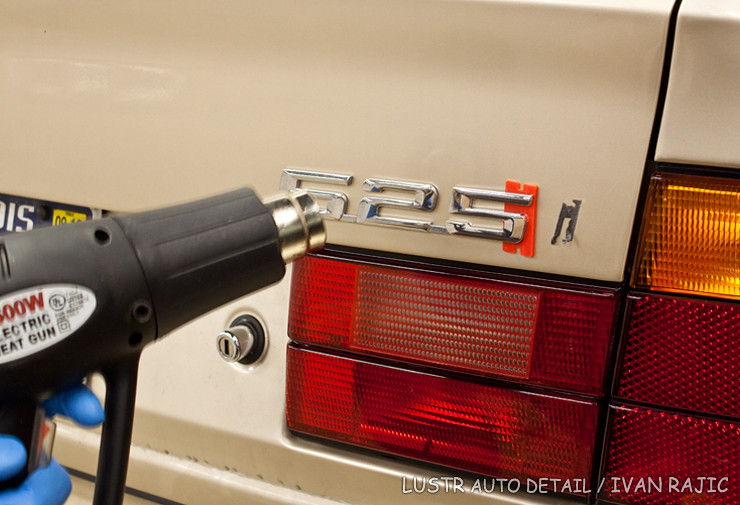 Using a plastic razor blade and heat gun to remove 95 BMW 525i badg