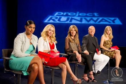 the judges sitting in stools on the runway