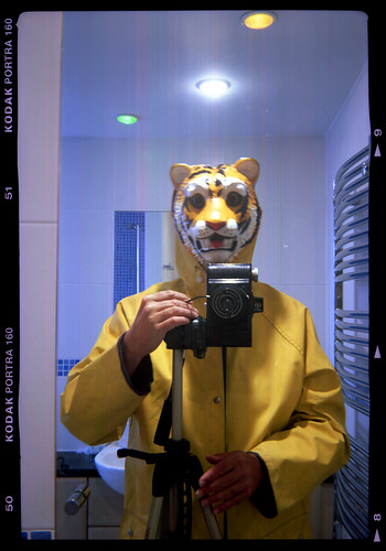 reflected self-portrait with Wembley Sport camera and tiger mask by pho-Tony
