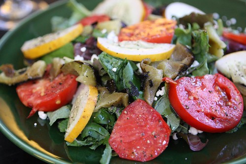 Tomato Kale Salad with Mixed Greens, Tomato, Cucumber, Grilled Pepper, and Feta