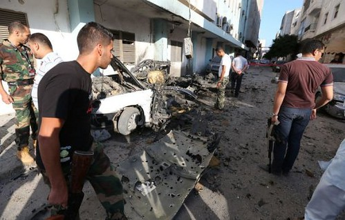 Occupied Libyan rebels inspect the impact of two car bombs which exploded in Tripoli. The blasts come just one year after the imperialist-backed invasion of the capital. by Pan-African News Wire File Photos