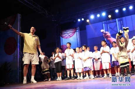 August 24th, 2012 - Yao Ming gets on stage at the performance of a primary school in Sichuan