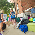 12-030 -- Roommates Tara Simpson '14 (left) and M.J. Zych '14 unload and sort their belongings before moving into Rust House, with help from M.J.'s dad Don Zyck.