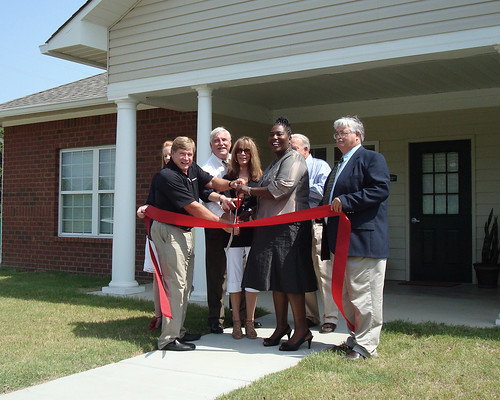 Mississippi Rural Development State Director Trina George (Third from right) helps cut a ribbon marking the opening of Rosedale Estates.